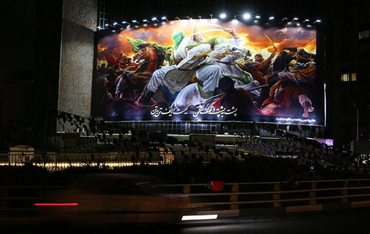 دیوارنگاره میدان ولیعصر(عج) به طرحی عاشورایی از حسن روحالامین مزین شد.